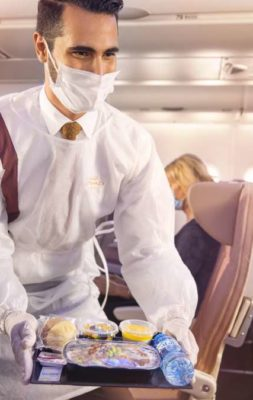 Etihad-Crew-onboard-with-PPE-serving-guests